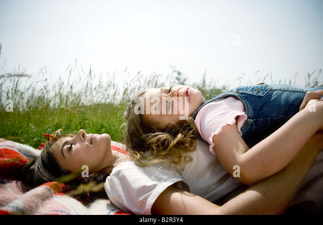 Mother and daughter asleep - Stock Image
