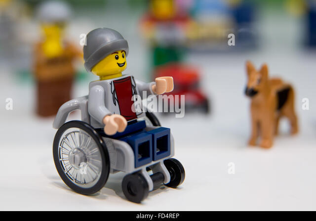 Nuremberg, Germany. 28th Jan, 2016. A Lego figure in a wheelchair can be seen next to a Lego dog at the stand for - Stock Image