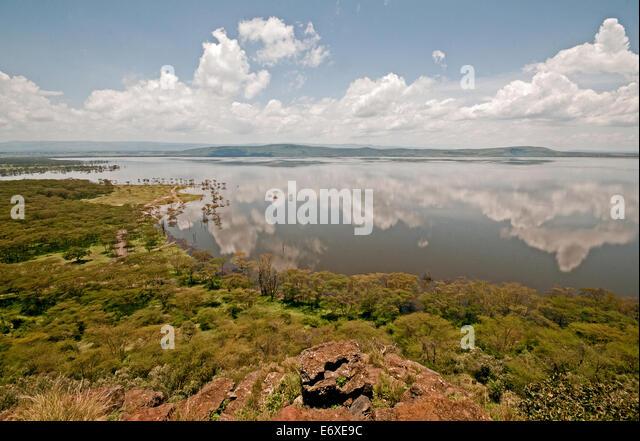 Panoramic view of flooded high level Lake Nakuru from summit of Baboon Cliffs Lake Nakuru National Park Kenya East - Stock Image