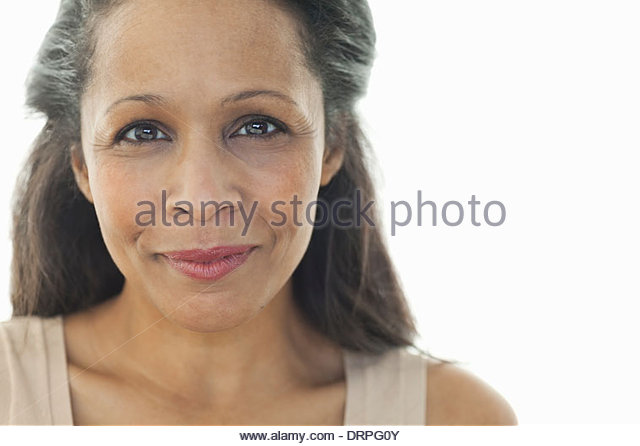 Close-up portrait of beautiful woman against white background - Stock Image