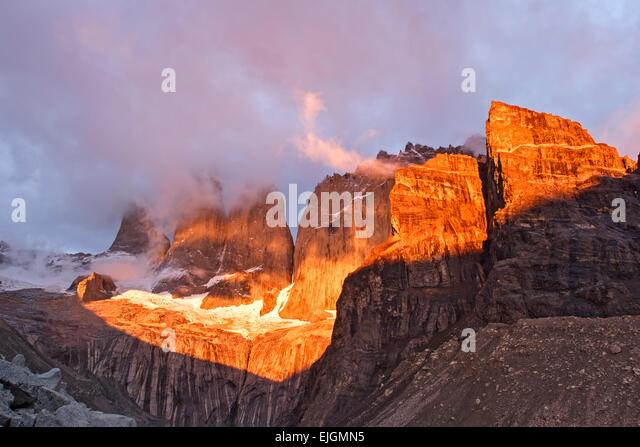 Las Torres (9,350 ft.) and morning clouds, Torres del Paine National Park, Patagonia, Chile - Stock Image