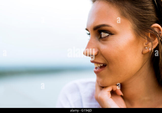 Beautiful young woman profile picture and a fashion stand - Stock Image