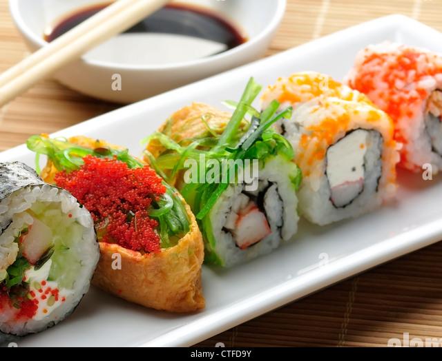 Sushi Assortment On White Dish, close up - Stock Image