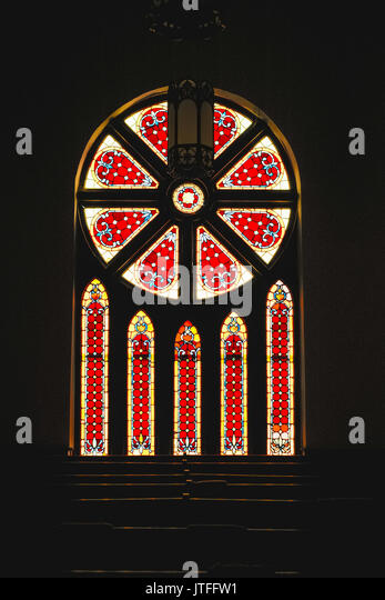 Stained glass windows in the United Methodist Church in Fort Deposit, Alabama. It was built in1899. - Stock Image