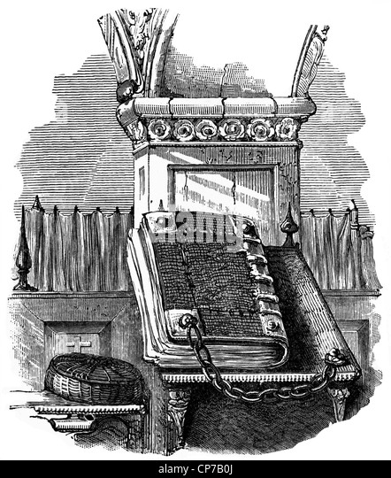 Engraving of holy bible chained to pulpit in Victorian church on white background. - Stock Image
