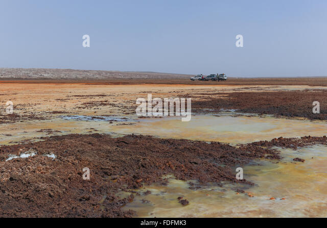 Strongly acid pools of water and salt slush scattered on the surface of the Dallol salt volcano in Ethiopia - Stock Image