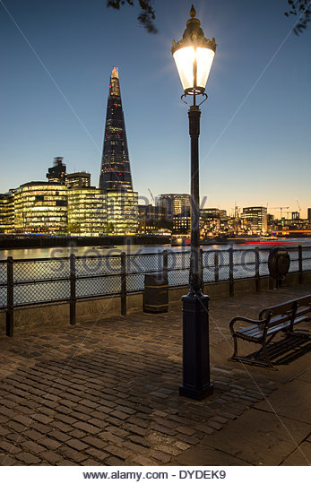 View of The Shard across River Thames in London at night. - Stock Image