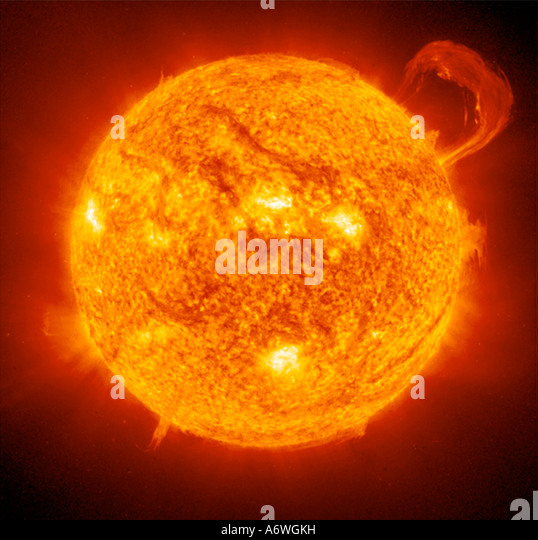 photograph of the sun taken with a huge telescope show flames erupting from the surface - Stock Image