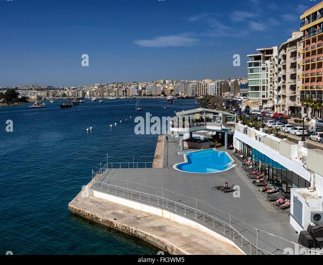 Sliema, Malta, a centre for tourist hotels, shopping, restaurants and café life across Marsamxett Harbour from - Stock Image