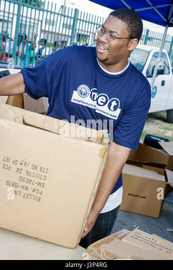 Miami Florida Little Haiti Thanksgiving Turkey Give-Away give away volunteers Black Haitian man Black Haitian man - Stock Image