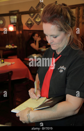 North Carolina Murphy ShoeBooties Cafe restaurant dining woman waitress server take order write job service industry - Stock Image