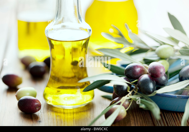 olive oil on wooden table - Stock Image