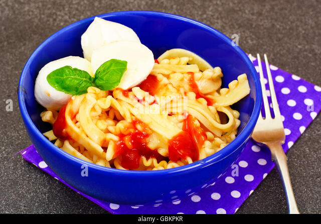 Pasta with Tomato Sauce Ketchup, Mozzarella and Basil - Stock Image