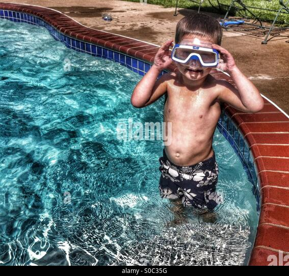 Funny picture of boy with snorkel mask - Stock Image