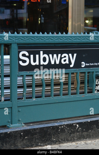 Urban Scene of a Subway Entrance Sign in New York City USA Copy Space - Stock Image