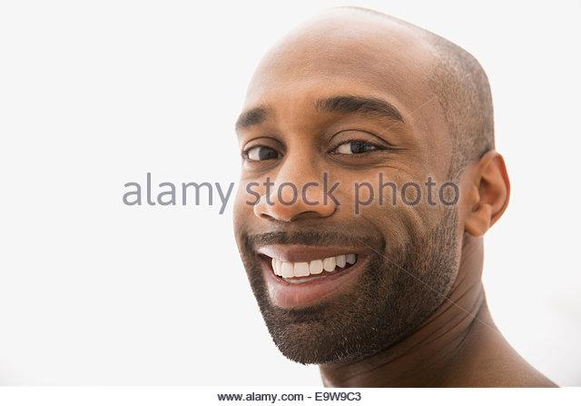 Close up portrait of smiling man with beard - Stock-Bilder