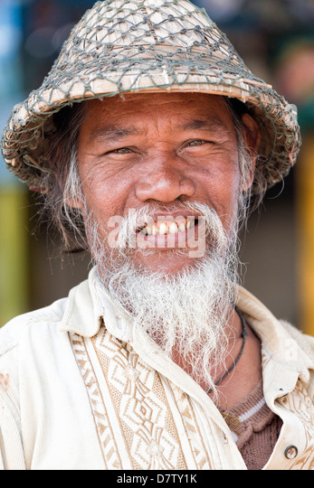 Local man wearing traditional bamboo hat, Amarapura, near Mandalay, Burma - Stock-Bilder