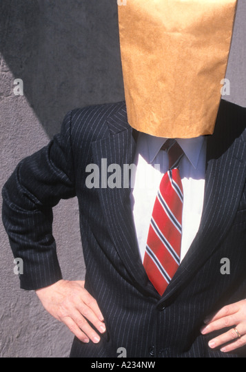 Businessman With a Blank Brown Paper Bag Over His Head - Stock Image