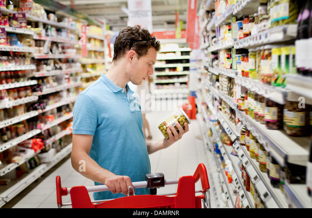 man in supermarket - Stock Image