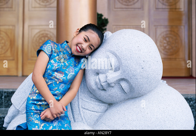 Young Girl / Child in Traditional Chinese Dress (Cheongsam), Beijing, China - Stock Image
