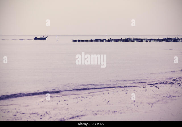 Nostalgic retro filtered sea landscape background. - Stock Image