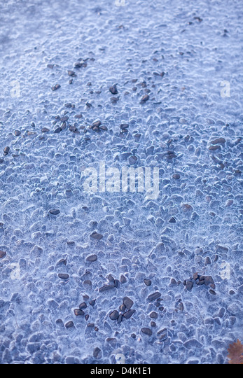 Holes in layer of ice - Stock Image