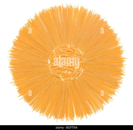 Wholemeal italian pasta over white background - Stock Image