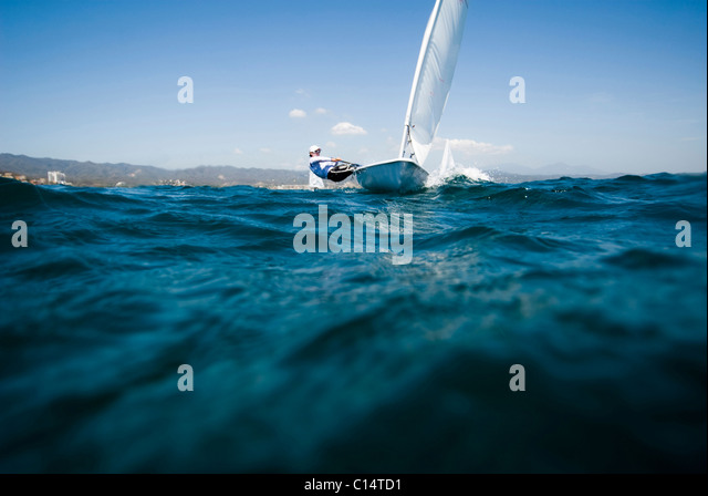 A female athlete Laser training in La Cruz, Mexico - Stock Image