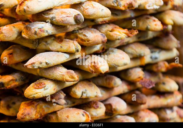 LONDON, UK Olive bread sticks at London's Borough Market. - Stock Image