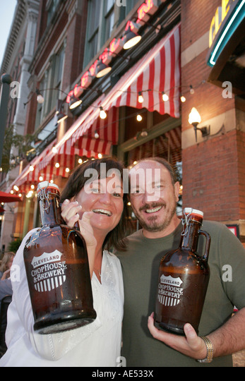Cleveland Ohio Warehouse District Cleveland ChopHouse and Brewery couple large bottles beer - Stock Image