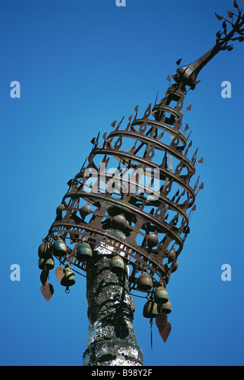 Metal chattra, leaning - Stock Image