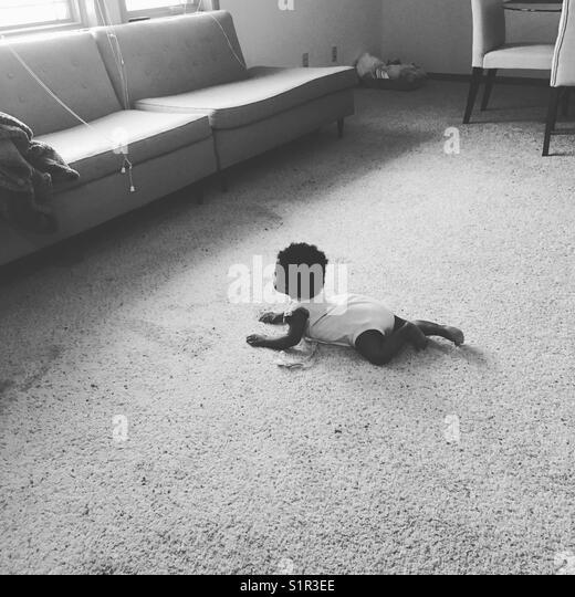 Baby crawling - Stock Image