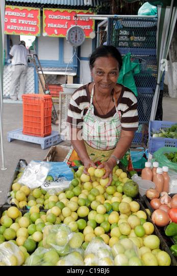 Panama City Panama Ancon Mercado de Mariscos market selling merchant retail shopping stall lemon lime fruit Hispanic - Stock Image