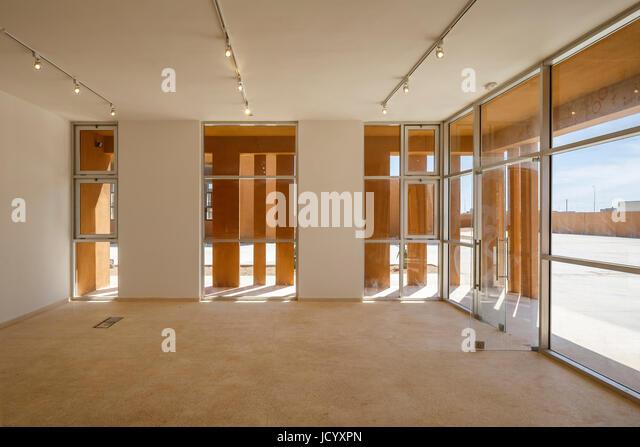 Glazed ground floor interior. Laayoune Technology School, Laayoune, Morocco. Architect: Saad El Kabbaj, Driss Kettani, - Stock-Bilder