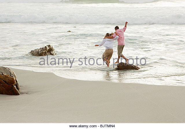 Couple having fun in the sea - Stock Image