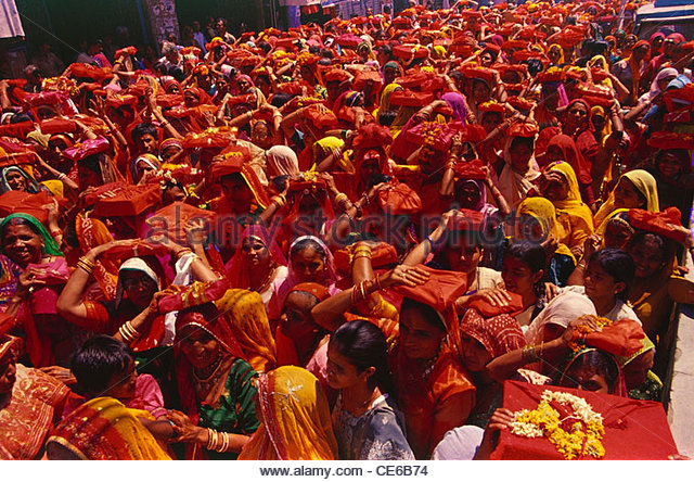 women procession religious book on head ; Jodhpur ; Rajasthan ; India - Stock Image