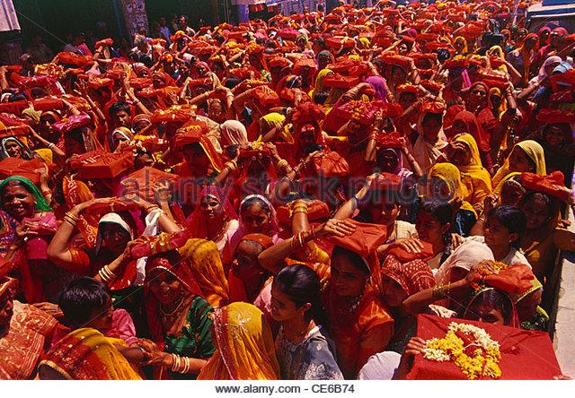 women procession religious book on head ; Jodhpur ; Rajasthan ; India - Stock Image