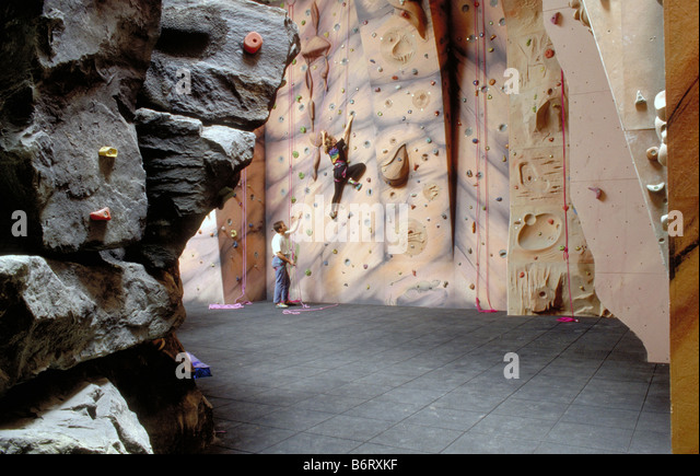 Climbers Climbing on Artificial Indoor Climbing Wall - Stock Image