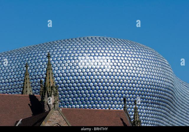 Birmingham's landmark 'Selfridges building' contrasting with St Martin's church, UK - Stock Image