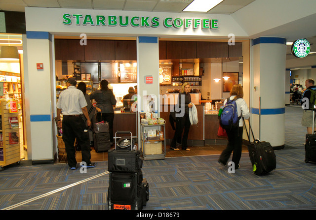 Virginia Sterling Washington DC D.C. Dulles International Airport IAD gate area concourse terminal Starbucks Coffee - Stock Image