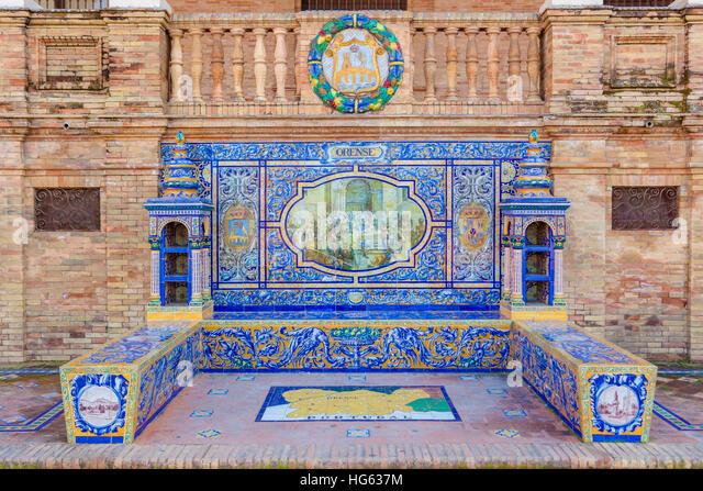 Glazed tiles bench of spanish province of Orense at Plaza de Espana, Seville, Spain - Stock Image