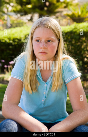 11 12 year old child children  Tween tweens young person people  Junior high age thinking serious thoughts thoughtful - Stock Image
