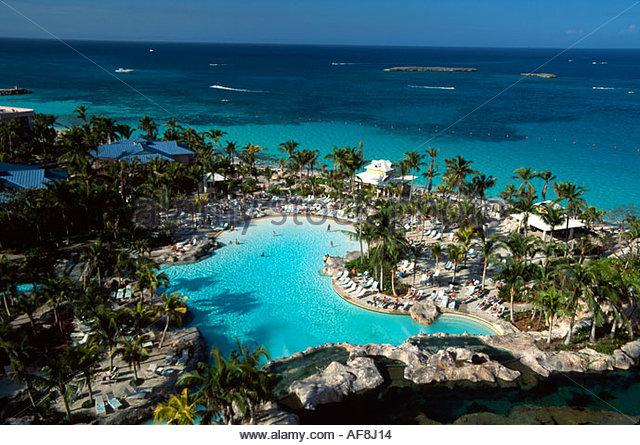 Bahamas New Providence Nassau Paradise Atlantis Resort pool palms beach - Stock Image