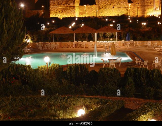Swimming pool and roman theatre in Bosra - Stock Image