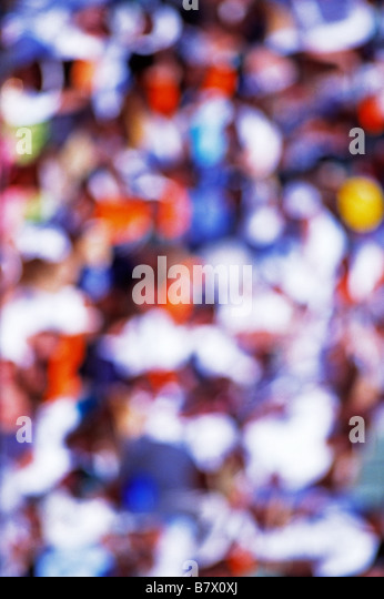 blurred crowd in stadium spectators - Stock Image