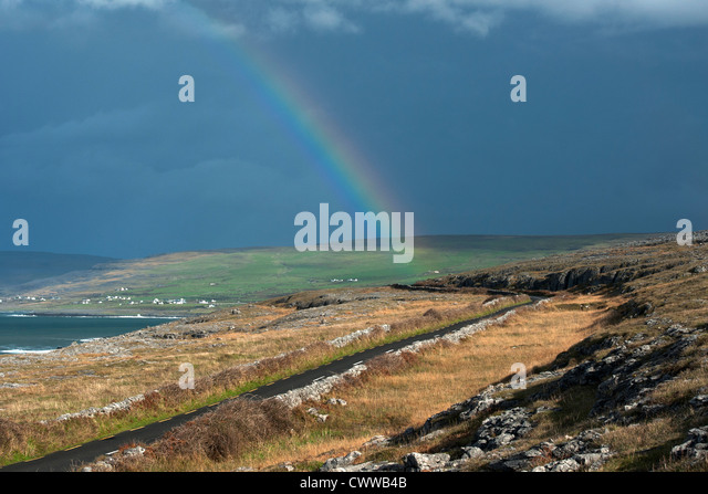 Rainbow over rural landscape - Stock Image
