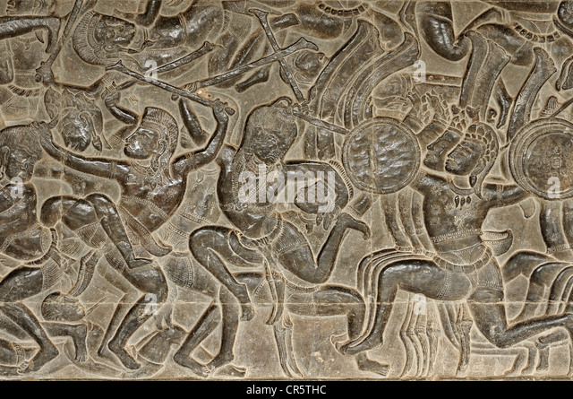 Section of the bas-relief in the West Gallery depicting scenes of the Battle of Kurukshetra from the Hindu epic - Stock Image