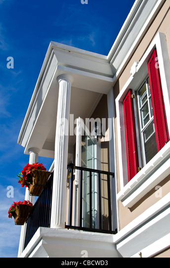 Roseau Dominica house in colonial French Style architecture with poinsettias Christmas decorations - Stock Image