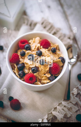 Cornflakes with blueberries and raspberries - Stock Image