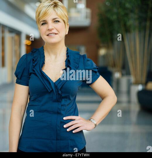 Portrait of woman in hallway - Stock Image